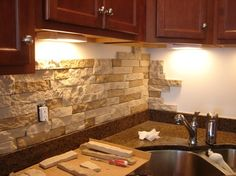 Awesome DIY stone back splash from Airstone! No power tools or grout. Priced at Lowe's for $50 for 8 sq ft.