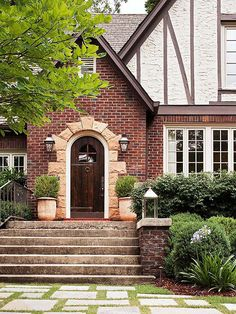 A stone-framed entry provides pleasing contrast to this home's brick exterior: http://www.bhg.com/home-improvement/door/exterior/exterior-doors-and-landscaping/?socsrc=bhgpin060314stoneaccent&page=2