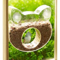 You (and your cats) can see the birds, but they can't see you in our Cat-Shaped One-Way Mirror Bird Feeder! This wildly entertaining bird feeder feature feature