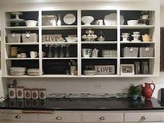 Love how these open cabinets are decorated