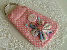 Would make a cute key chain or zipper pull for a tote bag or dance bag.  by:  Tea Rose Home