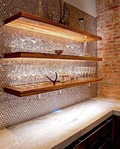 How stunning is this combination!! Brick + timber + glam penny rounds = Gorgeous!!  #backsplash