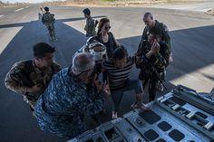 Sailors evacuate civilians after Typhoon Haiyan. | Flickr - Photo Sharing!