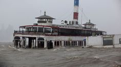 An historic ferry boat named the Binghamton is swamped by the waves of the Hudson River in Edgewater, N.J., Monday, Oct. 29, 2012 (AP Photo/Craig Ruttle)