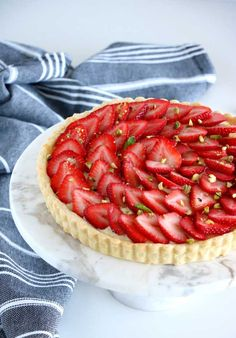 French Strawberry Tart with Pastry. Delicious and authentic French Strawberry Tart: sweet pastry crust creamy vanilla pastry cream and fresh strawberries on top. Desserts Français, French Desserts, Delicious Desserts, Tart Recipes, Baking Recipes, French Tart, Strawberry Recipes, Strawberry Tarts, Strawberry Custard Tart Recipe
