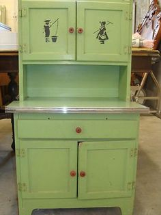 My mom threw away one of these green Hoosier cabinets when we moved into a dinky old farmhouse in the 60's!