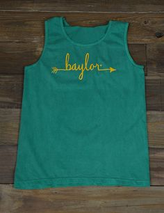 Follow your arrow straight to Baylor University! Show your love for your amazing school in this new BU Comfort Color tank! Sic 'em Bears
