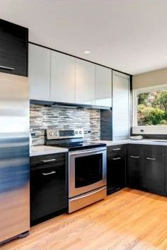For your base cabinetry and center island, our Black Wood Deep Grain Textured cabinet doors are the ideal option. A black marble countertop with grey and white veining makes for a perfect touch. #27estore #cabinets #blackkitchen