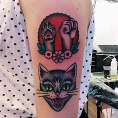 Traditional-style tattoos on arm
