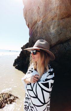 Janessa Leone hat, The Beach People round towel & Céline sunglasses. Via Mija