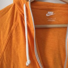 NWOT Nike hooded zip up Really cute orange zip up hoodie from Nike! NWOT! Size large, but would fit medium comfortably as well. Nike Tops Sweatshirts & Hoodies
