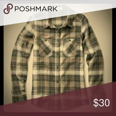 Nike 6.0 plaid flannel Nike 6.0 plaid button down shirt, soft and comfortable. Light grey, white with touch of pink. Super warm, perfect for camping, hiking or just hanging out. You'll love this shirt! Good condition! Nike Tops Button Down Shirts