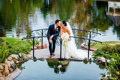 Bride and groom kissing on a bridge #weddingphotography / follow @TruePhotography