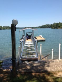 North Georgia Boat Lift & Marine Construction Company completed installation on a beautiful CAT 3 dock at Lake Chatuge, right in time for the 4th of July! Fitted with a single-slip combined with a wide-side, this dock features Ironwood decking. A gable roof protects this dock from any hail or persistant rainfall. Two 1/4″ Cables anchor the dock to shore, while a 60′ Arched Gangway anchors to shore! Boat Lift, Gable Roof, Decking, Blue Ridge, Anchors, Marina Bay Sands, Wind Turbine, Georgia, Arch