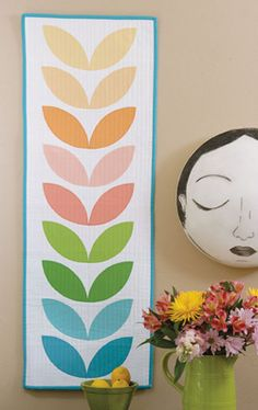 Petals by Corey Yoder can be a wall hanging or table runner. The colors are wonderful!