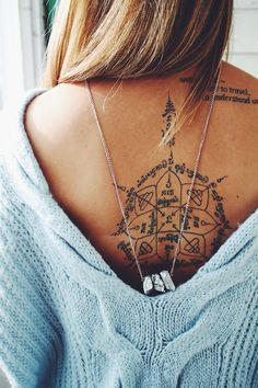 Back tattoo. I love everything in this pic from the tattoo to the necklace and even the low back sweater