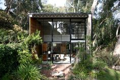 Eames House. I have the problem where I love big windows and lots of natural light, but I also want my privacy. I'd have to live on the 200th floor of some nasty city skyscraper. Or I could enjoy my happy little window-hut in the woods like this!
