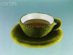 grass covered tea cup and saucer.