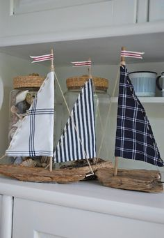 Check out these great driftwood sailboats with sails made out of nautical-look fabric scraps. I think you could also use long breadbaskets as the boat bottoms and put the bread for your buffet in them!