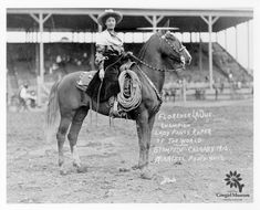 Cowgirl Hall of Fame Honoree Flores LaDue sitting on her horse in an outdoor arena. Photo taken at a Stampede in Calgary in 1912.  Permanent Collection of the National Cowgirl Museum and Hall of Fame