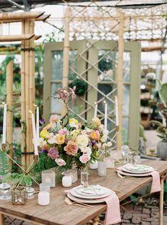 colorful wedding centerpieces - photo by Green Apple Photography http://ruffledblog.com/tropical-greenhouse-wedding-ideas
