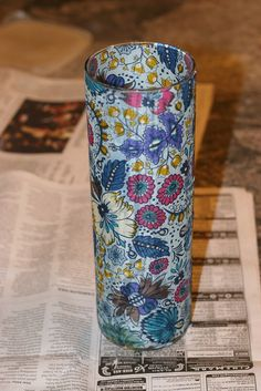 use mod podge & scrapbook paper/fabric to make a cute vase!