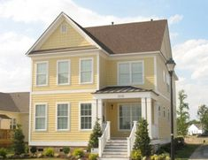 exterior house paint colors for brown roofs Siding Colors For Houses, Exterior Paint Colors For House, Paint Colors For Home, Exterior Colors, Paint Colours, Brown Roof Houses, Brown Roofs, Yellow Houses, House Siding