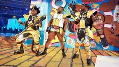 """Xavier Woods on How Anime and Wrestling Came Together at WrestleMania 32  Last weekend at WrestleMania 32 uber-popular tagteam New Day made an eye-catching entrance by emerging from a giant box of their """"Booty-O's"""" cereal dressed as Dragon Ball Z characters.  The WWE trio is known for their pop-culture references and tributes to movies anime video games and more. We spoke with New Day member Xavier Woods about the DBZ entrance as well as his love for anime.   (L-R) Xavier Woods Big E and…"""