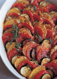 Vegetable Tian - from the Barefoot Contessa (Ina Garten).  This is one of my absolute favorite veggie side dishes ever.  If you can't get zucchini you can substitute japanese eggplant slices - equally good.  I usually cook it longer - so it sort of falls in on itself...very toothsome :o) whatever that means....yummmmm!