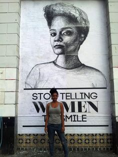 """Tatyana Fazlalizadeh, local Brooklyn badass, with an image from her """"Stop Telling Women to Smile"""" street art project that addresses gender based street harassment."""