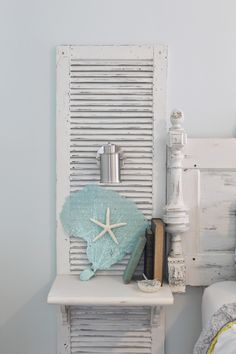 Beachy nightstands, custom made shutter nightstands. Paired with reclaimed door headboard, using parts and pieces from old tables, and beds. Nautical sconce mounted to shutter. Large, aqua painted sea fan, paired with starfish.The ragged wren : Shabby-Beach Bedroom