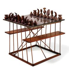 MAX ERNST, Chess Set and Board, 1944 (prototype). Material stained wood, glass and mixed media on paper. Wooden table stand by Xenia Cage (1944). / Study Blue