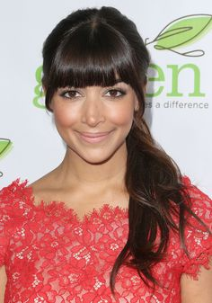 Hannah Simone separated her blunt bangs out before securing her hair in a ponytail. To make sure you get all the short hairs out, hold hair back loosely and comb the short, loose hairs forward.