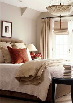 gray walls, white bedding, tufted bed, red sham