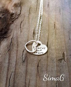 i carry your heart   - inspired by the beautiful poem by E E Cummings -The price is for ONE necklace   sterling silver tiny heart SimaG