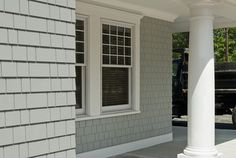 This house has Hardi Shingle siding, which is a cement board siding. Low maintenance and FIRE PROOF!