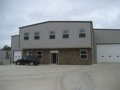 This is a pre engineered metal commercial two-story building with a brick facade and a cantelevered mezzanine/2nd floor for the offices upsatirs. It also has a 2 bay loading dock and large commercial roll up door.