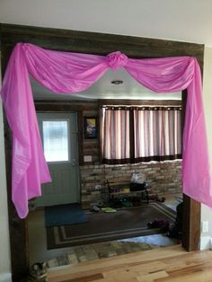 Doorway decoration for princess party made from plastic table covers. In blue!