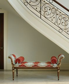 Foyer bench detail, bolsters, wrought iron railing.