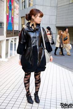 d3841ad12af1 Girl in shiny black Emoda coat over striped Kawi Jamele dress.