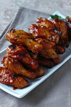Mouthwatering Spicy Maple Chicken Wings.  Throw these on a well greased BBQ for a short minute for extra crispness.  YUMMY.