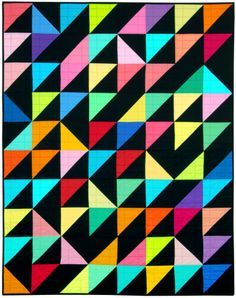 Turning Triangles quilt using Kona Cotton Solids HSTs in the Bright color story, designed by Allie Heath. FREE from Robert Kaufman Fabrics.