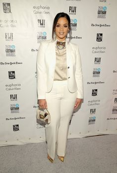 Dascha Polanco opted for a white suit that she paired with gold accents in a bowtie, clutch, and pointed heels for a chic look.
