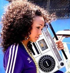 B-Girl flow: boom box, dookie chain, big hair, Adidas track jacket