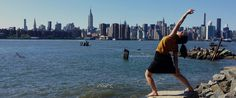 Peaceful warrior pose against the New York skyline.