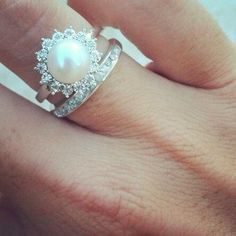 diamond and pearl wedding rings 2015 This is my dream ring. Pearl and diamonds Halo Engagement Rings, Diamond Wedding Rings, Halo Diamond, Diamond Rings, Pearl Diamond, Pearl Wedding Rings, Traditional Engagement Rings, Beautiful Wedding Rings, Dream Wedding