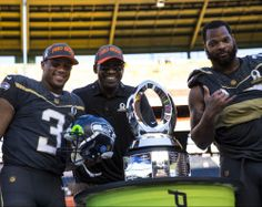 HONOLULU, HI -  SUNDAY, JANUARY 31:  Jerry Rice, Team Irvin quarterback Russell Wilson #3 of the Seattle Seahawks Michael Irvin, and defensive end Michael Bennett #72 of the Seattle Seahawks pose with the Pro Bowl Trophy after the end of the 2016 NFL Pro Bowl at Aloha Stadium on January 31, 2016 in Honolulu, Hawaii.Team Irvin defeated Team Rice 49-27.  (Photo by Kent Nishimura/Getty Images)