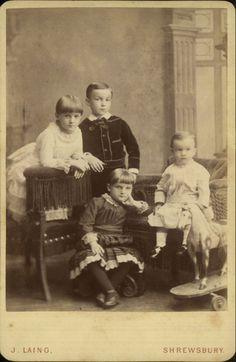 Victorian cabinet photograph of four children. Photographer: J. Laing, Shrewsbury, UK.