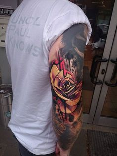 This rose tattoo looks unreal. Artist: Uncl Paul Knows. Photo from www.facebook.com/unclpaulknows.