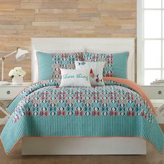 The Vera Bradley Go Fish Quilt livens up your bed with a fun coastal vibe. With a modern fish pattern and artistic stripes with a bold border, this bright quilt adds a touch of color to your bed and complements any beach-themed bedroom. Beach Quilt, Beach Bedding, Twin Quilt, Quilt Bedding, Bedding Sets, Beach Themed Quilts, Vera Bradley, Coastal Quilts, Coastal Bedding